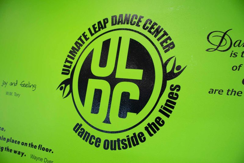 Ultimate Leap Dance Center Green Wall with Logo