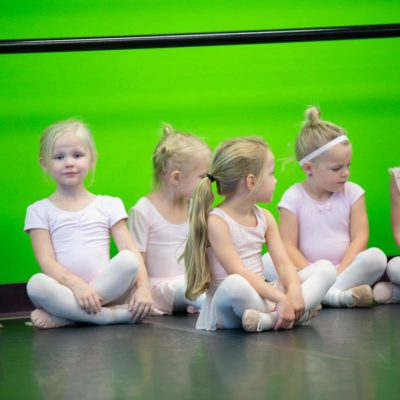Young Dancers in pink wait for dance rehearsal to start