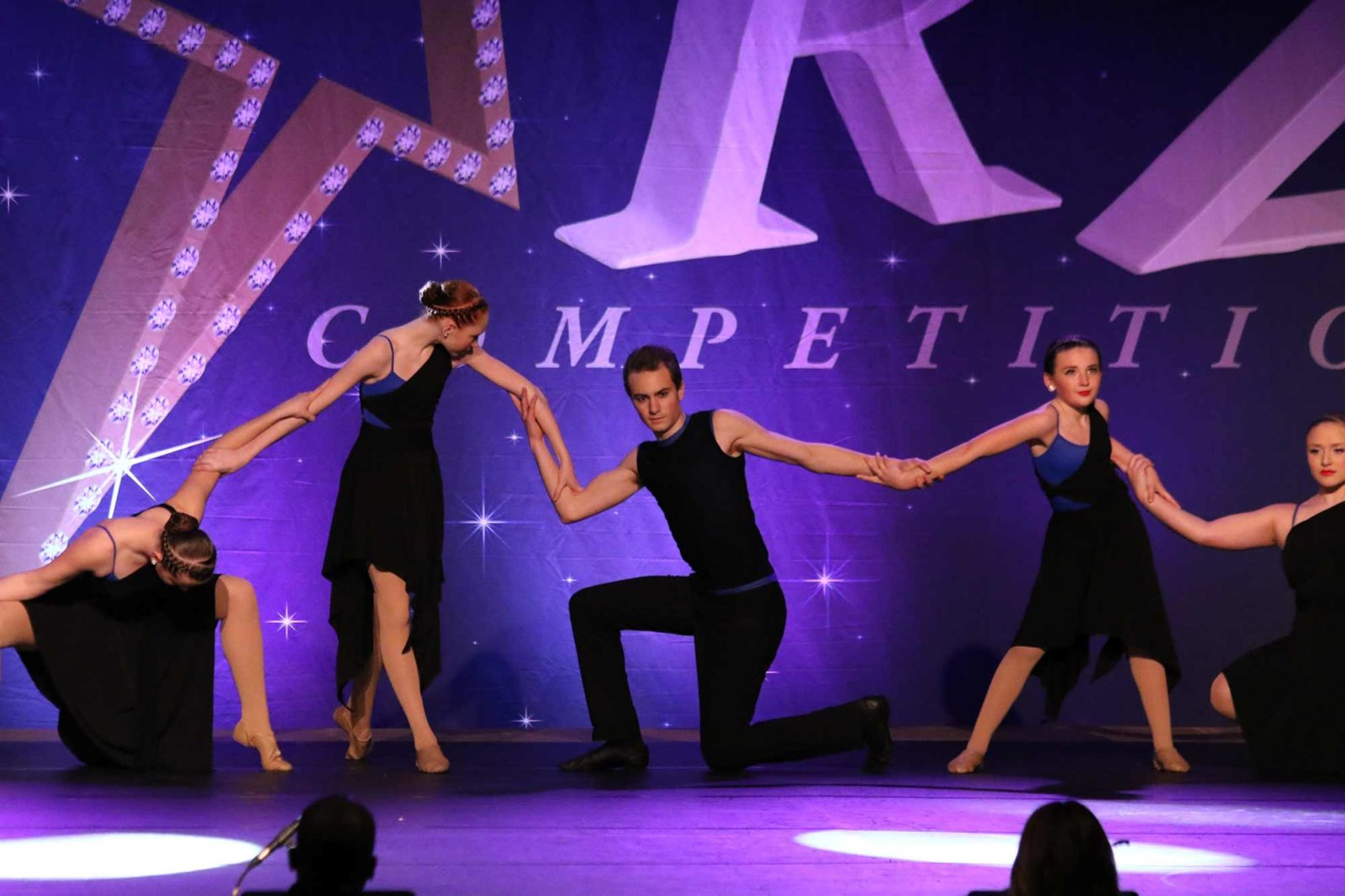 Dancers performing at a dance competition