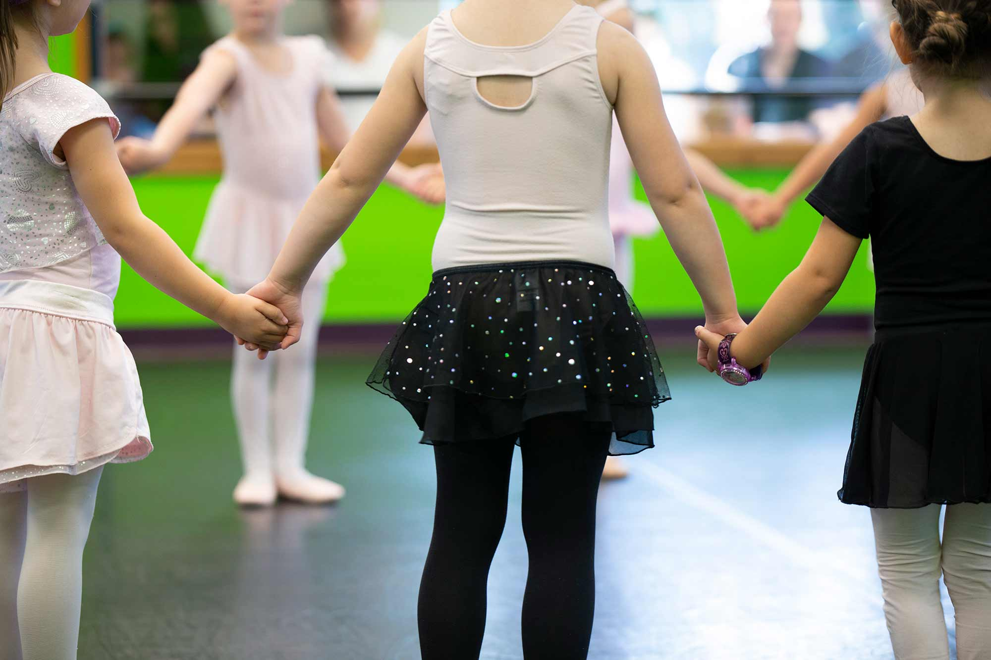 Young dancers holding handing during dance practice